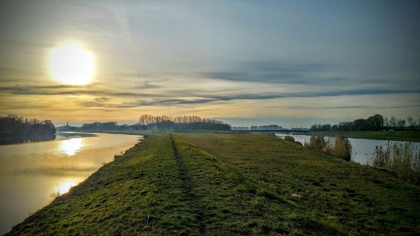 Beauty In Nature Cloud - Sky Day Field Grass Green Color Lake Landscape Nature No People Outdoors Reflection Scenics Sky Sun Sunset Tranquil Scene Tranquility Tree Water