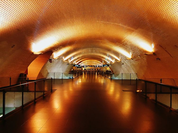 My Favorite Place Railing Illuminated Indoors  Architecture Ceiling Built Structure The Way Forward Bridge - Man Made Structure Footbridge Electric Light Famous Place Modern Elevated Walkway Diminishing Perspective Long Arch Underpass Underground Subway Station Metro Station