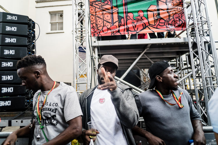 Notting Hill Carnival 2016 Casual Clothing Leisure Activity Lifestyles Looking Medium Group Of People Person Retail  Young Adult Young Men