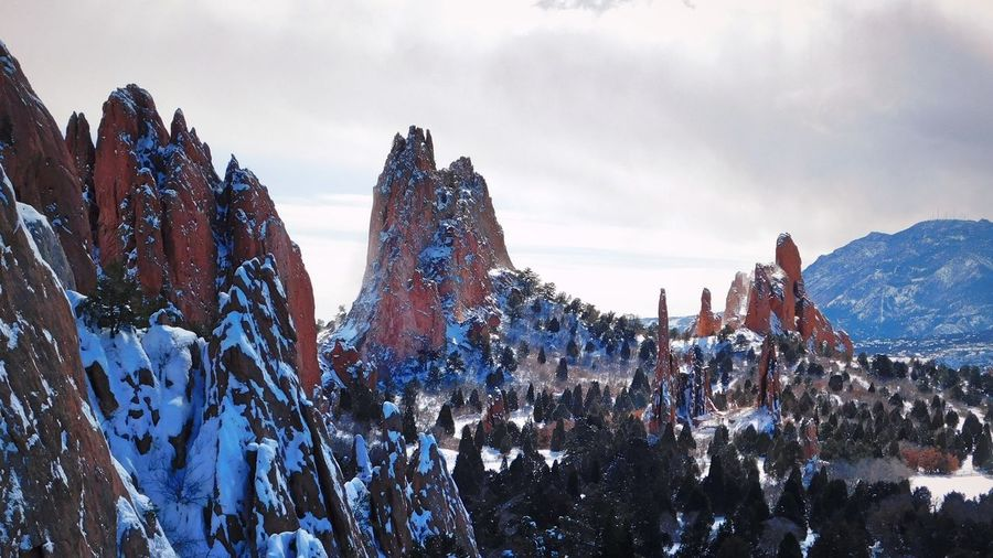 Garden of the Gods Rock Formation Wallpaper Architecture Beauty In Nature Building Exterior Built Structure Cloud - Sky Cold Temperature Day Environment Landscape Mountain Mountain Peak Mountain Range Nature No People Outdoors Panoramic Scenics - Nature Sky Snow Snowcapped Mountain Tranquil Scene Winter
