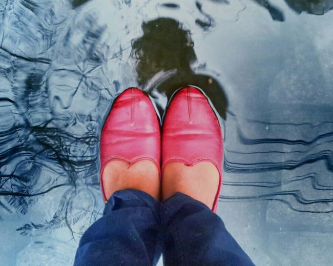 My Reflection is Under my Feets.. :) Low Section Human Leg Shoe Personal Perspective One Person Red Human Body Part Standing High Angle View Day Water Outdoors