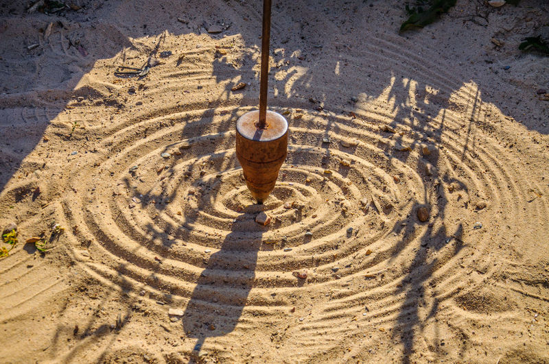 High angle view of carving on sand