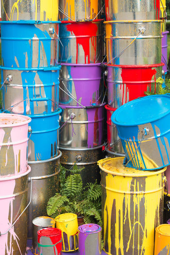 Multi Colored Container Bucket No People Yellow Large Group Of Objects Day Drum - Container Variation Choice Architecture Outdoors Plastic Retail  Garbage Bin Vibrant Color Blue Close-up In A Row Nature