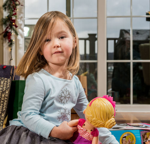 Happy preschool toddler with christmas gifts and presents and playing with her new dolly Christmas Doll Dolly Happy Preschool Age Presents Xmas Child Childhood Cute Gift Girl Indoors  Parcel Portrait Pretty Real People Toddler  Unwrapping