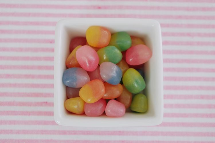 Close-up of candies in plate on table