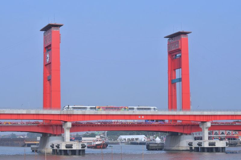 ampera bridge River Light Rail Transit LRT Ampera Bridge Water Red Nautical Vessel Lighthouse Bridge - Man Made Structure Business Finance And Industry Industry Clear Sky Sky Architecture Arch Bridge Riverbank Bascule Bridge Container Ship Suspension Bridge Riverside Steel Cable Shipyard Chain Bridge Cargo Container Cable-stayed Bridge Smoke Stack Crane - Construction Machinery Air Pollution Commercial Dock