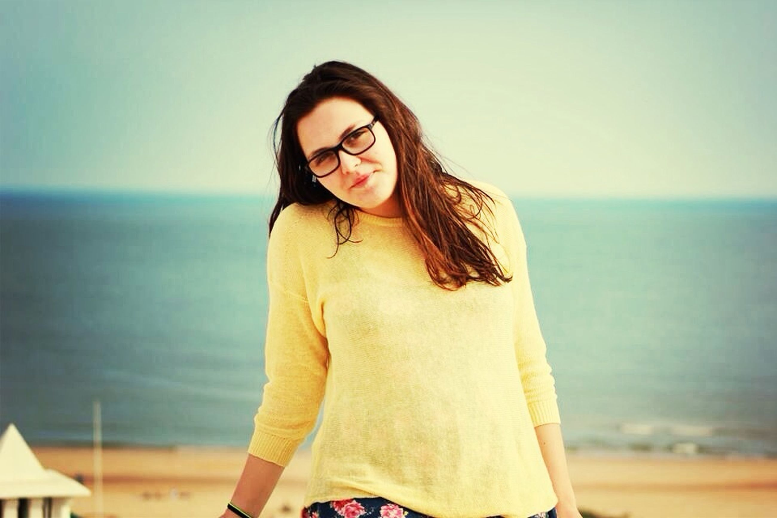 young adult, person, lifestyles, young women, looking at camera, portrait, sea, leisure activity, sunglasses, front view, casual clothing, beach, standing, water, focus on foreground, three quarter length, long hair