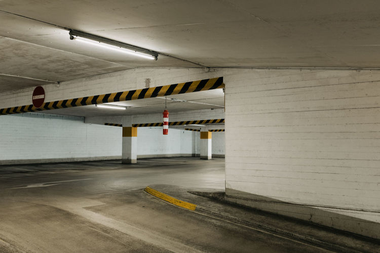 UNDERGROUND Architecture Indoors  Absence Transportation Parking Lot No People Empty Ceiling Built Structure Parking Garage Wall - Building Feature Garage Sign Subway Illuminated Architectural Column Communication Road Public Transportation Security Concrete