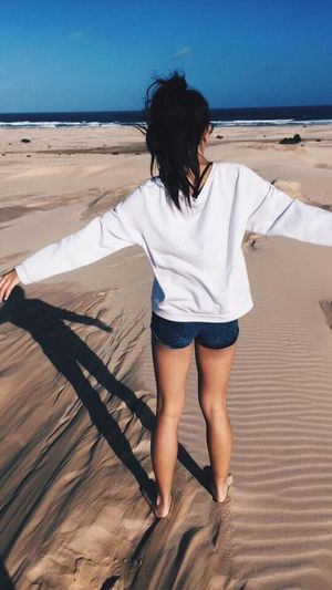 Rear View Sunlight Full Length Young Women Shadow Horizon Over Water Young Adult Sea Casual Clothing Person Water Tranquil Scene Day Tranquility Scenics Nature Sky Outdoors Beauty In Nature Vacations