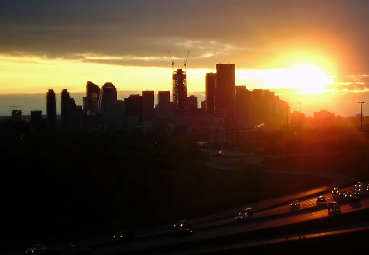 Sunset from my place :) Sunset Skyline Cityscape Urban Views Sun Sun Silhouette Clouds Skyporn Skyscrapers Downtown City Under Construction Orange Traffic Road Hilltop View Calgary Headlights The Architect - 2016 EyeEm Awards