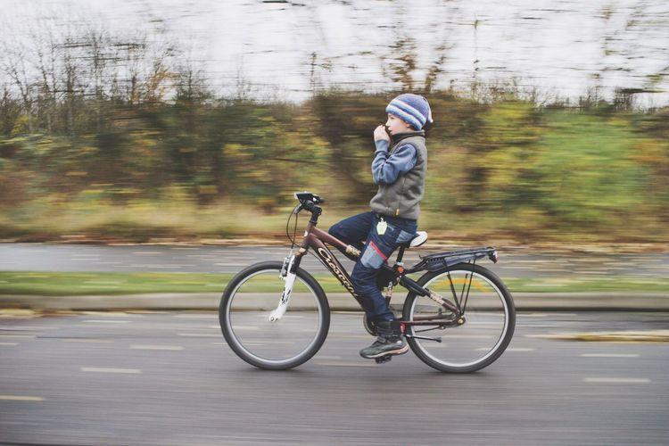 Man riding bicycle in lake