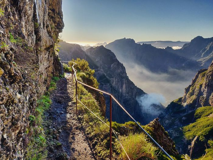 High angle view of panoramic shot of hiking path and mountains against sky