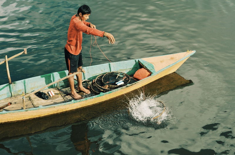 Fisherman Boat Fishermen's Life EyeEmNewHere EyeEm Best Shots EyeEm Nature Lover EyeEm Selects Gondola - Traditional Boat Water Nautical Vessel Oar Occupation Rowing Men Standing Kayak Lake Fishing Boat Fisherman Canoe