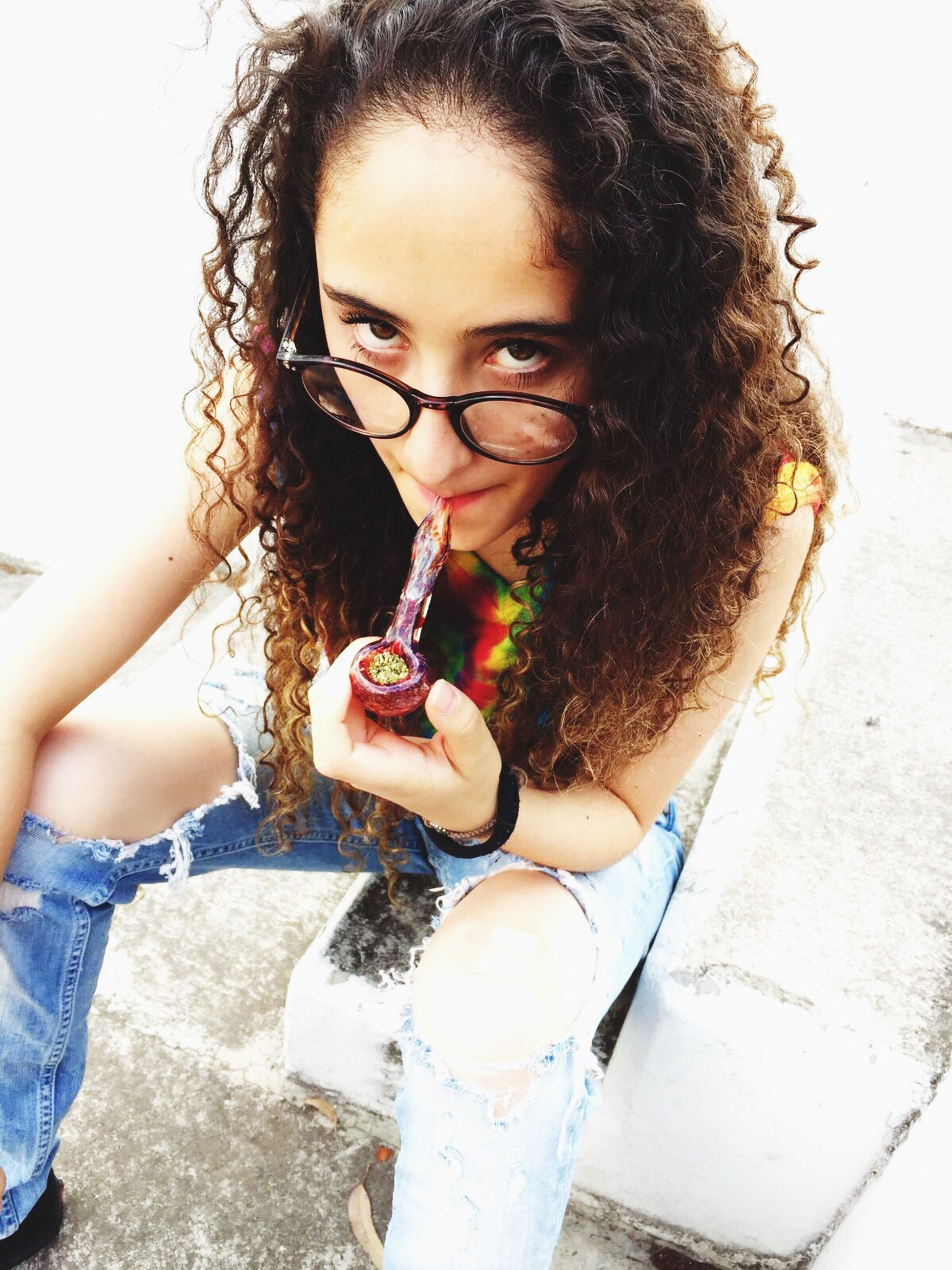 young adult, long hair, beauty, young women, one young woman only, beautiful woman, beautiful people, portrait, one person, curly hair, confidence, close-up, eyeglasses, human lips, women, people, real people, outdoors, one woman only, adult, adults only, day, only women, freshness, human body part