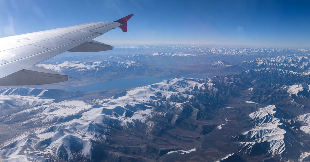 Aerial view of snowcapped mountains during winter