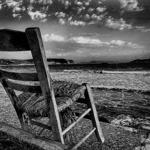 Lonely Chair looks at the horizon -. Methoni Emptychair Blackandwhite Lonelychair Tranquility Nature Chair Tranquil Scene Relaxation Horizon Over Water