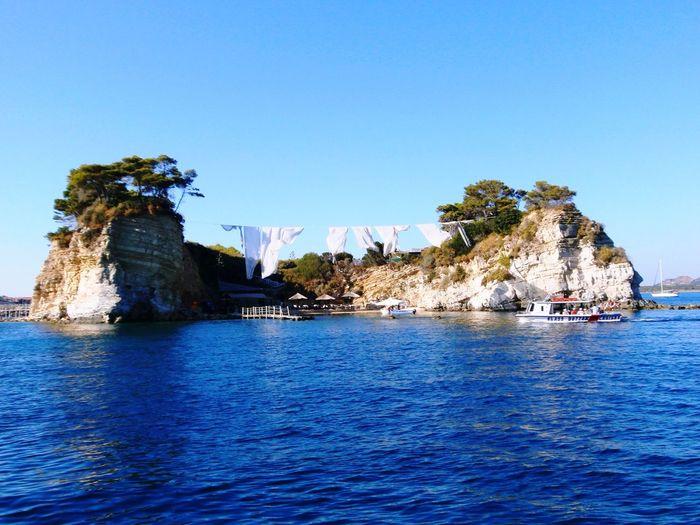Island Blue Sea Washing Line Strange Washing Drying Unusual Rock Plants
