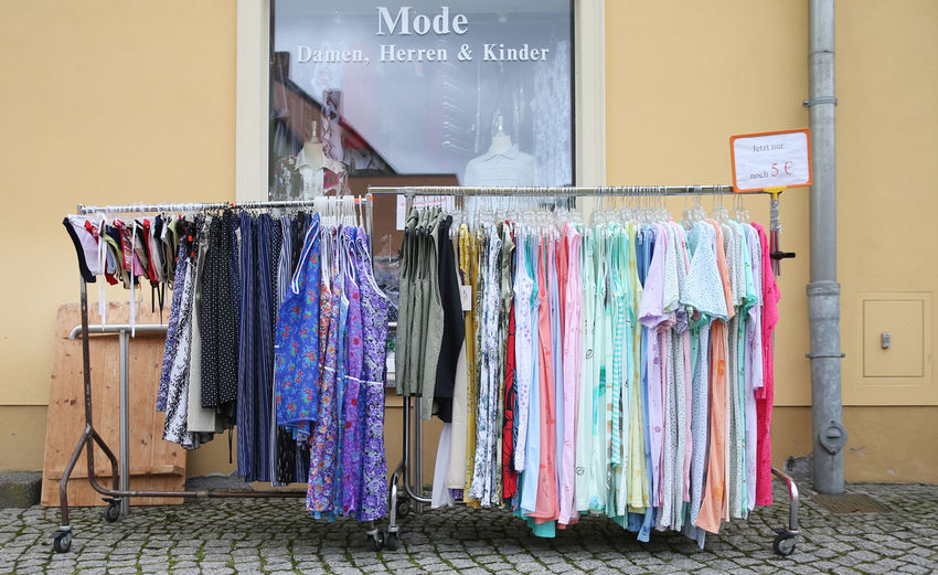 Womenswear for sale against building