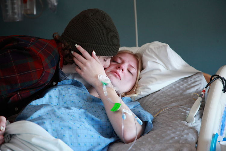 Man Kissing  Woman In Hospital