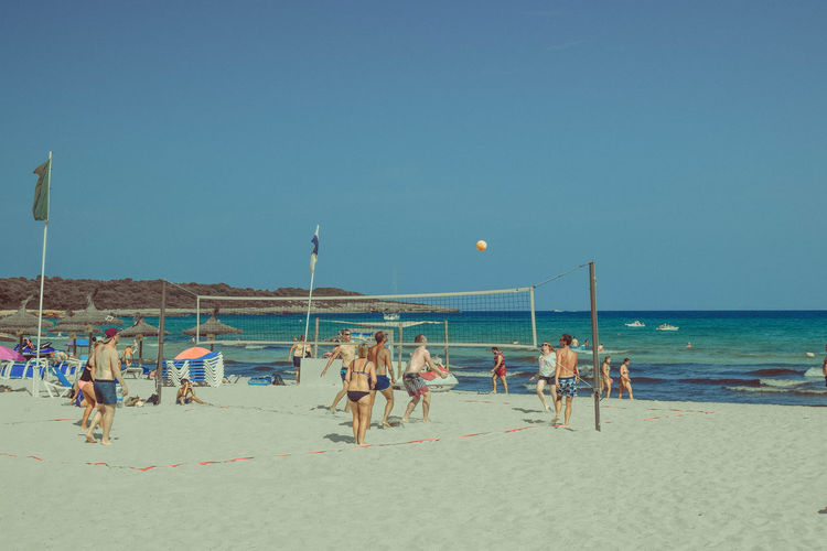 Sky Sea Water Beach Land Horizon Over Water Clear Sky Sand Nature Outdoors Parasols Beach Photography Group Of People Holiday Crowd Vacations Large Group Of People Beach Volleyball Copy Space