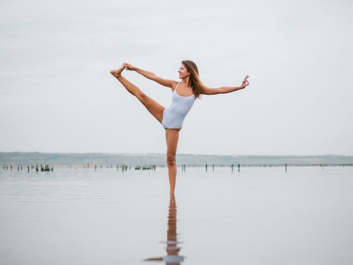 Water Sea One Person Young Adult Beach Full Length Standing Yoga Long Hair Beautiful Woman Young Women Nature Barefoot Balance Tranquil Scene Outdoors Summer Leisure Activity Beauty