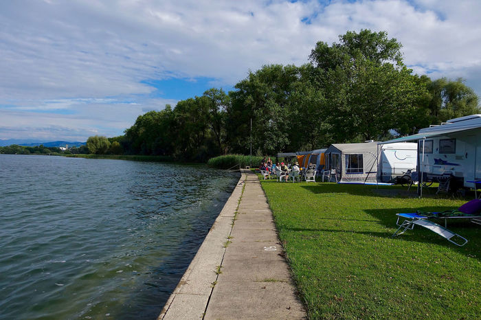 On the campground in Arbon, Switzerland. Arbon Beauty In Nature Campground Cloud Cloud - Sky Cloudy Day Diminishing Perspective Grass Green Green Color Leisure Activity Lifestyles Nature Outdoors Sky Switzerland Tranquil Scene Tranquility Tree Vanishing Point Water