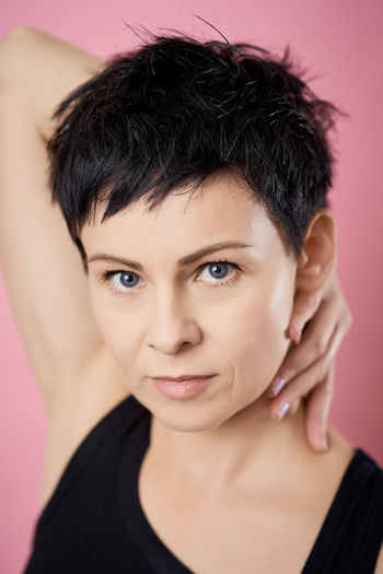 Portrait Headshot One Person Looking At Camera Indoors  Front View Close-up Body Part Human Body Part Colored Background Hair Adult Young Adult Studio Shot Black Hair Lifestyles Hairstyle Focus On Foreground Human Face