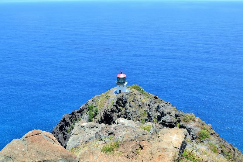 High Angle View Of Lighthouse On Cliff Against Sea At Hawaii Islands