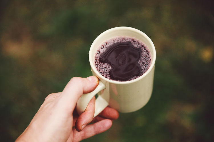 Autumn Close-up Coffee Cup Cup Day Drink Focus On Foreground Food And Drink Freshness Grape Harvest Grape Juice Grapevine Holding Human Body Part Human Hand One Person Outdoors People Real People Refreshment Stum Food Stories Autumn Mood