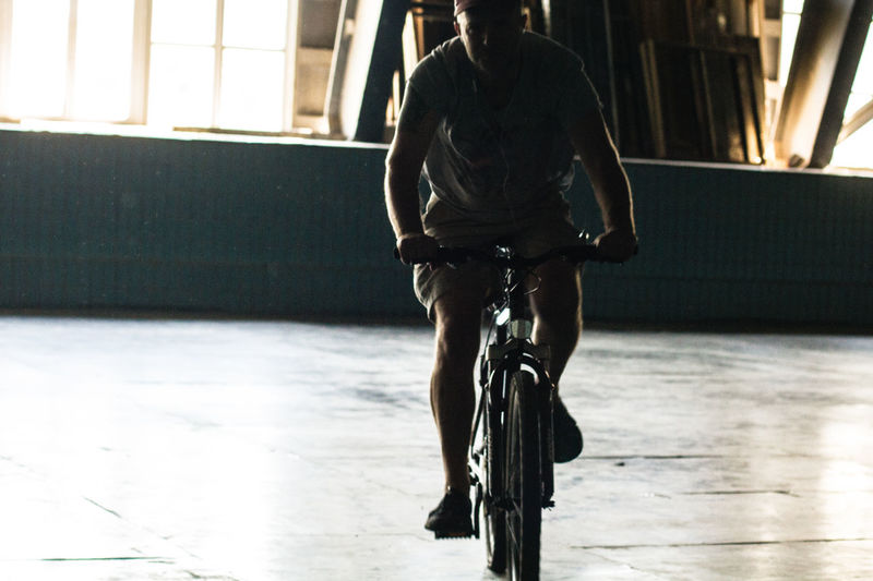 Man riding bicycle in building