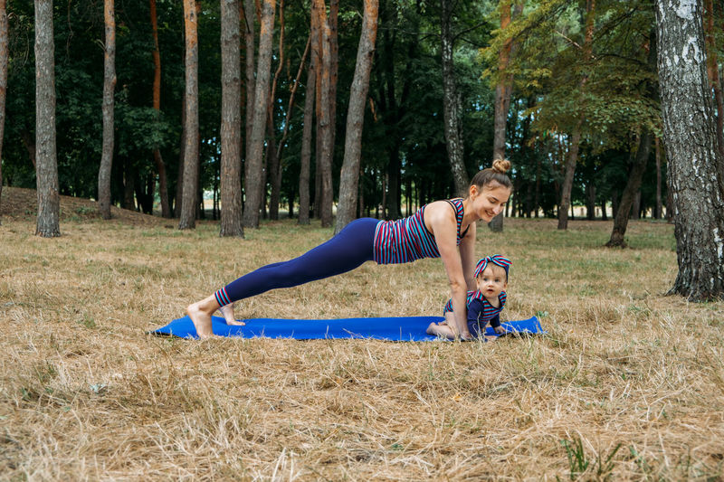 Mom and baby yoga outdoor classes. wellness, family yoga class, practicing mindfulness