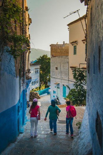 Childhood Africa Archietecture Blue Chefchaouen Childhood Children Childs City Fun Girl Girls Kids Light Morocco Old People Play Run Sky Street Sun Travel Urban White Young