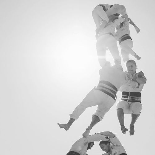 Cultura Catalana Castellers Human Towers Sky Copy Space Real People Low Angle View Sunlight Day Positive Emotion Two People Full Length People Women Leisure Activity