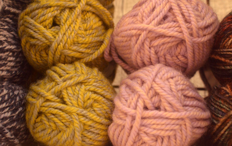 Mix of mohair for knitting Wool Textile Ball Of Wool Close-up Art And Craft No People Craft Material Creativity Indoors  Choice Multi Colored Softness Variation Yellow Orange Color Man Made Gray Man Made Object Warm Clothing