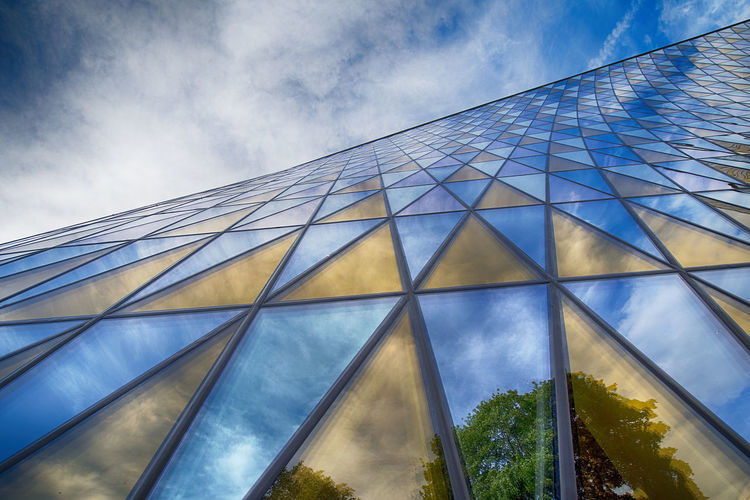 Aula medica from low angle view in Solna, Sweden. Architecture Aula Medica Building Exterior Built Structure City Cloud - Sky Day Karolinska Institutet Low Angle View Modern No People Outdoors Sky Solna Travel Destinations