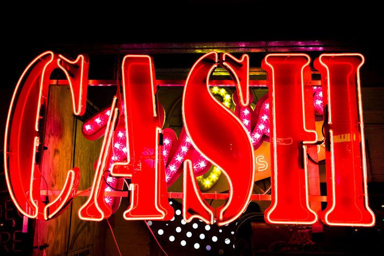 Addiction Betting Cash Casino Close Up Communication Gambling Illuminated Lighting Money Neon Night No People Outdoors Red Text Vibrant Colour Wealth
