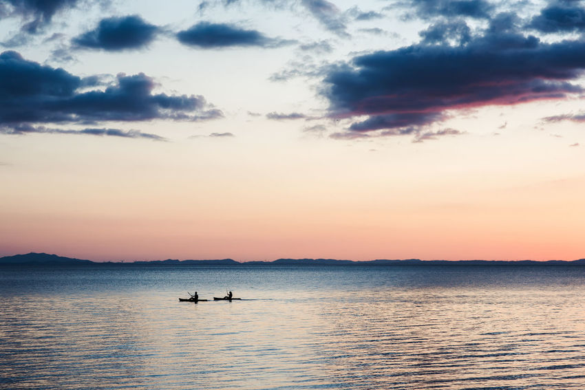 Only the sound of the water Beauty In Nature Cloud - Sky Day Kayak Lake Mode Of Transport Nature Nautical Vessel Ometepe Island Orange Color Outdoors Real People Relax Sea Silhouette Sky Sport Sunset Tranquil Scene Tranquility Transportation Water Waterfront