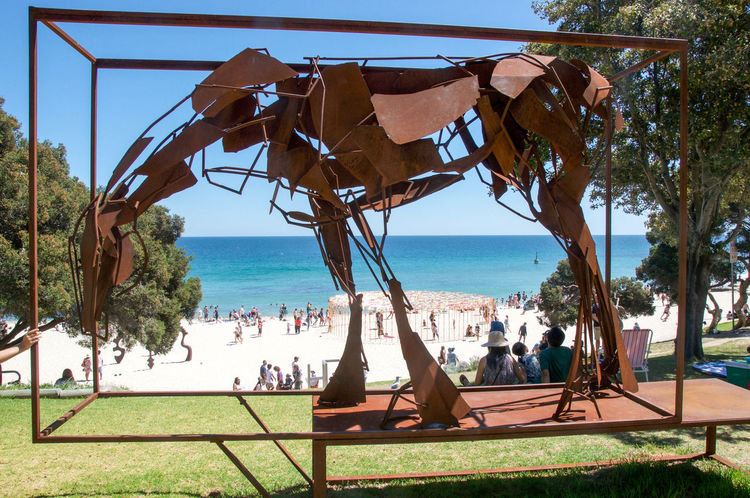 View through metal horse sculpture overlooking crowds at the Sculptures by the Sea arts event at Cottesloe Beach in Western Australia. Artistic Arts And Entertainment ArtWork Beach Cottesloe Creativity Crowd Culture Elevated View Foreshore Horizon Over Water Horse Indian Ocean Interactive  Metal Metalwork Nature People Sculpture Sculptures By The Sea Seascape Tourist Attraction  Travel Destinations View Through Western Australia
