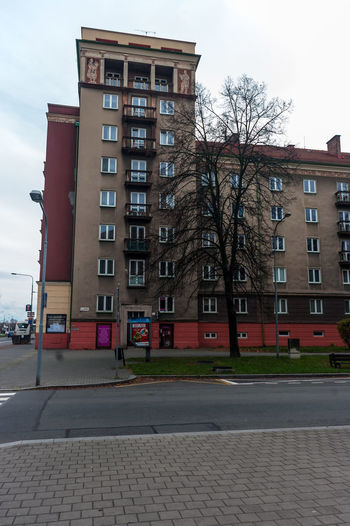 View of building by street against sky