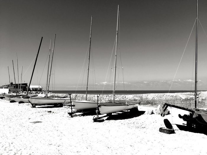 Wissant, Côte d'Opale Lenkacam ShotOnIphone IPhone Black And White Photography Black & White Black And White France Côte D'Opale Opale Coast Wissant Nautical Vessel Transportation Moored Mode Of Transport Boat Mast No People Outdoors Sea Nature Water Beach Tranquility Sailboat Sand Sky Clear Sky Scenics