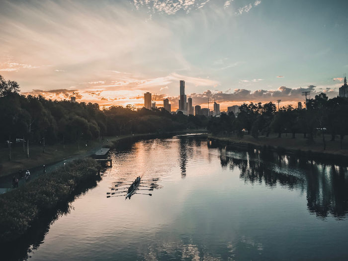 Scenic view of river and buildings against sky during sunset in melbourne
