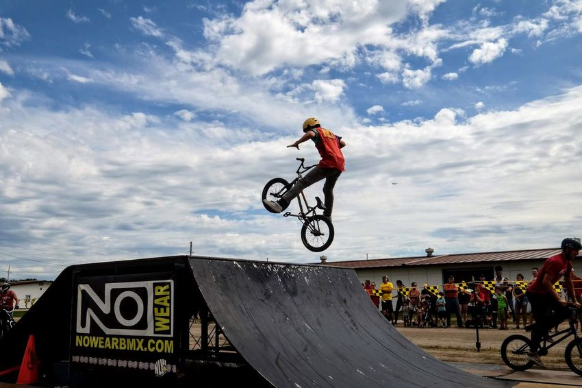 Nowear BMX Team Nebraska State Fair September 1, 2018 Grand Island, Nebraska Camera Work Check This Out EyeEm Best Shots FUJIFILM X-T1 Fujinon 10-24mm F4 Getty Images Grand Island, Nebraska Nebraska State Fair NowearBMX Photo Essay Photo Journalism Skill  Stunt Action Bicycle Bmx  Cloud - Sky Communication Day Events Extreme Sports Eye For Photography Freestyle Fujifilm_xseries Headwear Helmet Leisure Activity Lifestyles Men Motion One Person Outdoors Ramp Real People Riding S.ramos September 2018 Series Sign Skill  Sky Sport Sports Helmet Stunt Transportation