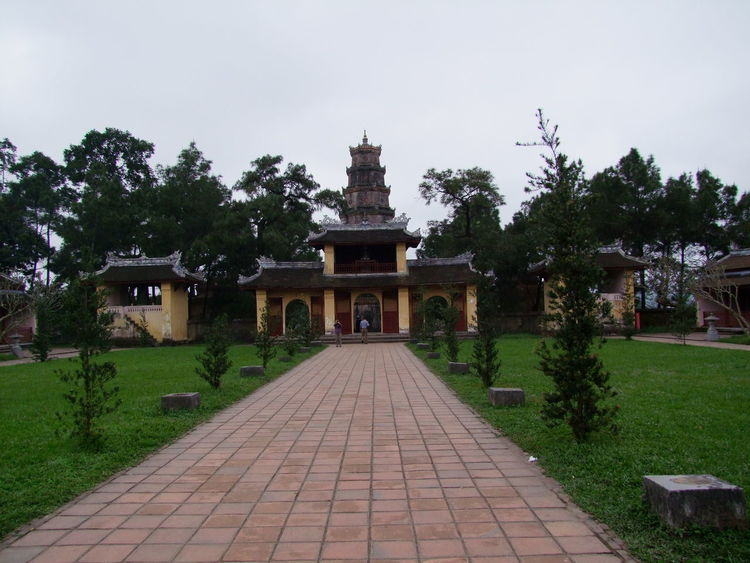 Entrance to Thien Mu Pagoda Architecture Building Exterior Built Structure Composition Day Footpath Formal Garden Grass Green Color History Huế Incidental People Lawn Outdoor Photography Outdoors Park - Man Made Space Pathway Plant Religion Thien Mu Pagoda Tourist Attraction  Trees Vietnam Walkway White Clouds