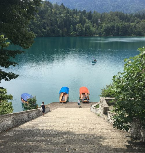 Steps leading towards pletna boats moored on lake bled