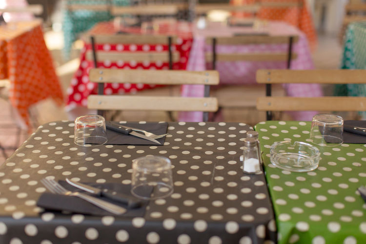 Shallow depth of field view of street cafe tables at Aix-en-Provence Arrangement Cafe Dots Entertainment Focus On Foreground Food And Drink Group Of Objects Kitchen Utensils Man Made Object No People Outdoors Selective Focus Street Table Cloth