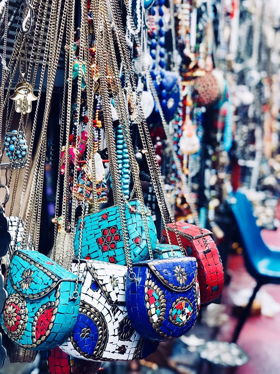 for sale, no people, day, retail, multi colored, focus on foreground, hanging, large group of objects, market, choice, abundance, retail display, store, variation, art and craft, outdoors, close-up, selective focus, small business, religion, consumerism, street market