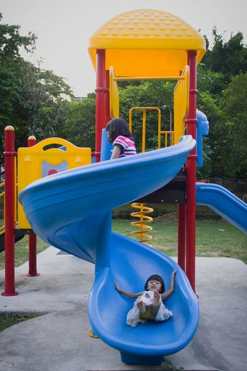 Playground Outdoor Play Equipment Childhood Playing Child Park - Man Made Space Tree Fun Leisure Activity People Outdoors Friendship Day Sky Children Only The Week On EyeEm Outdoor Photography Outdoor Paint The Town Yellow