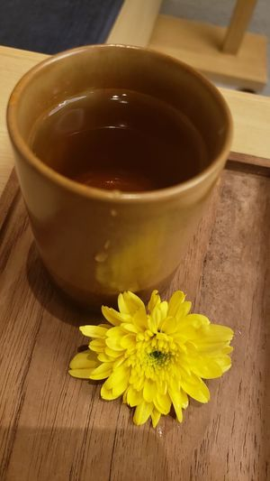 High angle view of yellow flower on table