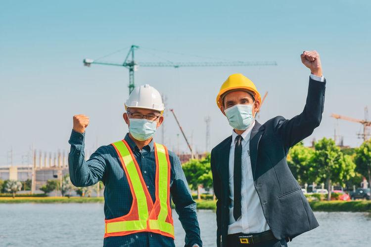 Men standing on construction site