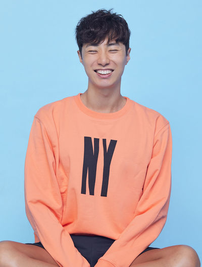 Portrait of smiling man against blue background